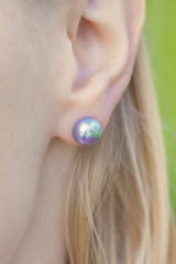 woman's ear with a pearl earring