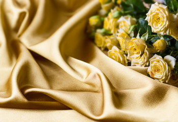 Yellow roses on silk background