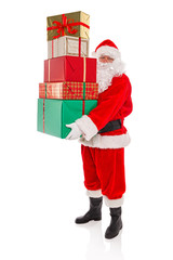 Father Christmas holding a stack of presents, isolated on white