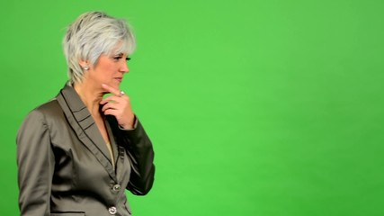 business woman walks and thinks - green screen
