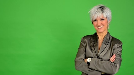 business middle aged woman smiles (fold arms) - green screen