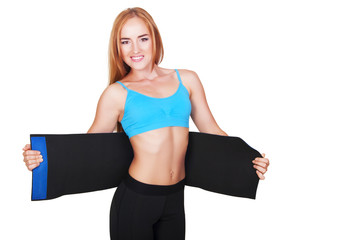 Woman doing fitness using belt for weight loss