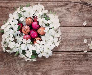 Easter egg in nest from white flowers