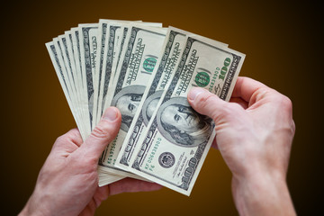 holding money dollars