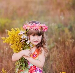 beautiful girl hugging a bouquet