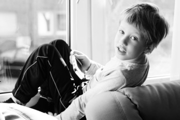 Cute boy using a mobile phone