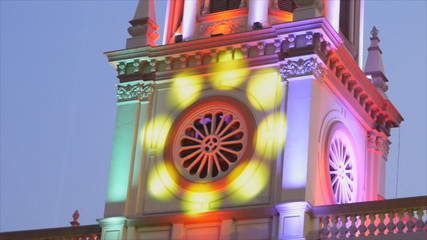 Movement of colorful lighting on top of church
