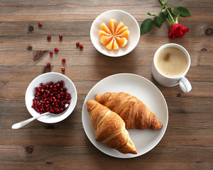 Breakfast with fresh croissants and milk coffee