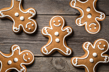 Gingerbread cookies on wooden background.