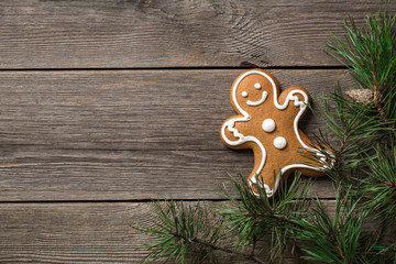 Gingerbread cookie on wooden background with festive decoration