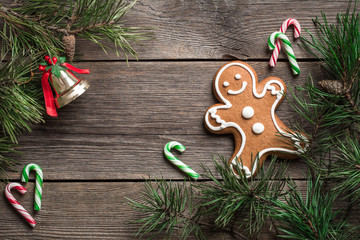 Gingerbread cookie and candy canes with festive decoration