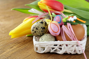 Easter still life with spring flowers tulips and eggs