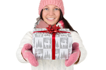 Young woman holding Christmas gift in hands. Isolated on white