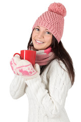 Attractive young woman in winter clothes with red cup.