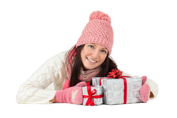 Happy young woman with Christmas presents or gifts.