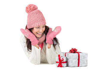 Happy and surprised young woman with Christmas presents or gifts
