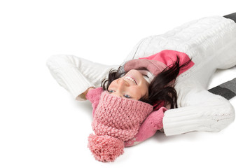 Attractive young woman in warm outfit laying on the floor.