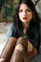 Girl in torn tights
