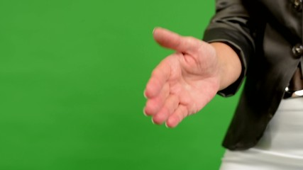 business woman gives a hand in greeting - green screen - closeup