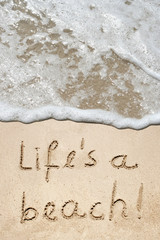 Conceptual life is a beach text in sand and water