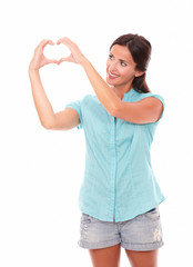 Pretty latin lady looking at a love sign