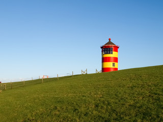 Pilsum, lighthouse at North sea of Germany.
