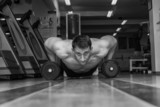 Gym man push-up strength pushup exercise with dumbbell  poster