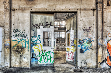 Large tagged door inside an abandoned factory