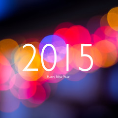 New year sign on blurred bokeh background. Happy New Year card