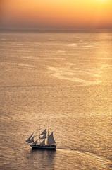 Ship at sunset in Oia, Santorini, Greece