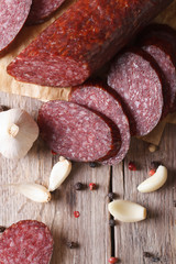 Fresh smoked sausage on a table close up vertical, rustic