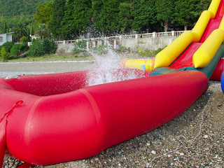 Red and yellow inflatable slides