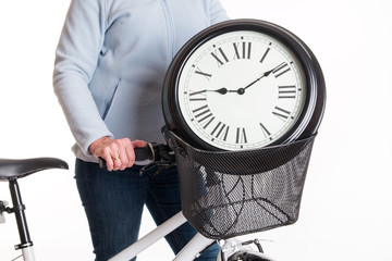 The clock in the bicycle basket