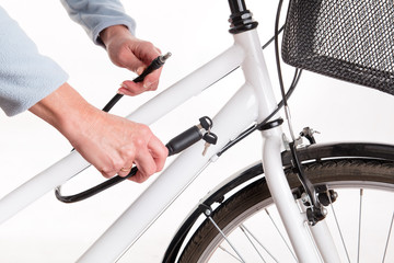Securing the bike with a chain with a key