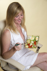 Woman eating an egg salad Healthy eating concept