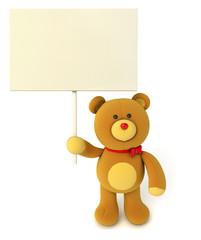 Toy teddy bear holding blank board