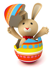 Cute funny toy rabbit hatches from the Easter egg