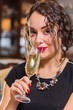 Portrait of beautiful romantic brunette with a champagne glass