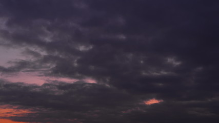 Sunset colored dark clouds timelapse - wide shot