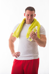 man holding a bottle of milk in hand, a towel around his neck