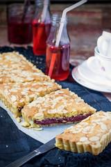 English traditional Bakewell tart with raspberry jam