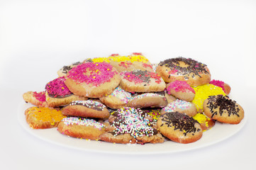 White plate with colored biscuits
