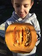 Child hold cut pumpkin