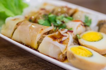 spring rolls on old wood with spicy sauce, vegetables and in noo