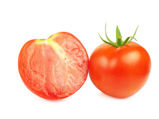 Tomatoes, whole and sliced, seed free, isolated over white.
