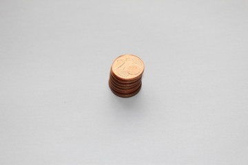 Piled up two cents on a white background