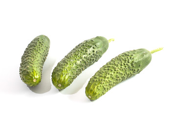 Green, raw cucumber, on white background.