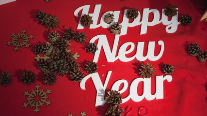 "Cones fall to the text: ""Happy New Year"""