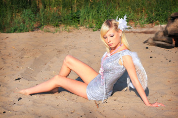 Beautiful young girl on sand