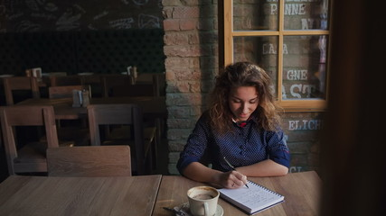 Young woman working or study in a cafe